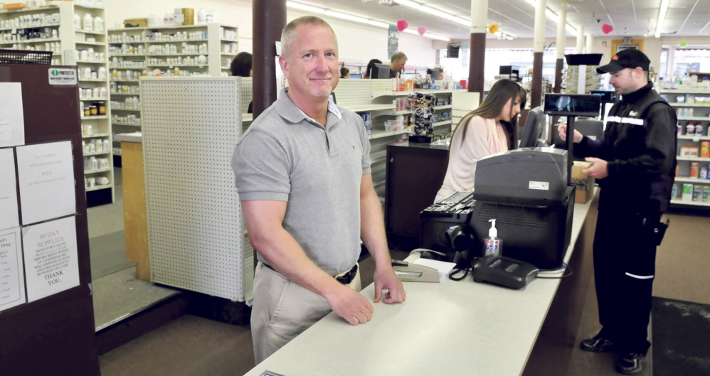 MOVING: Kevin Holland stands behind the counter Thursday at his Variety Drug store in Skowhegan. Holland is planning to move the business a short distance away to the former USDA lot in town.