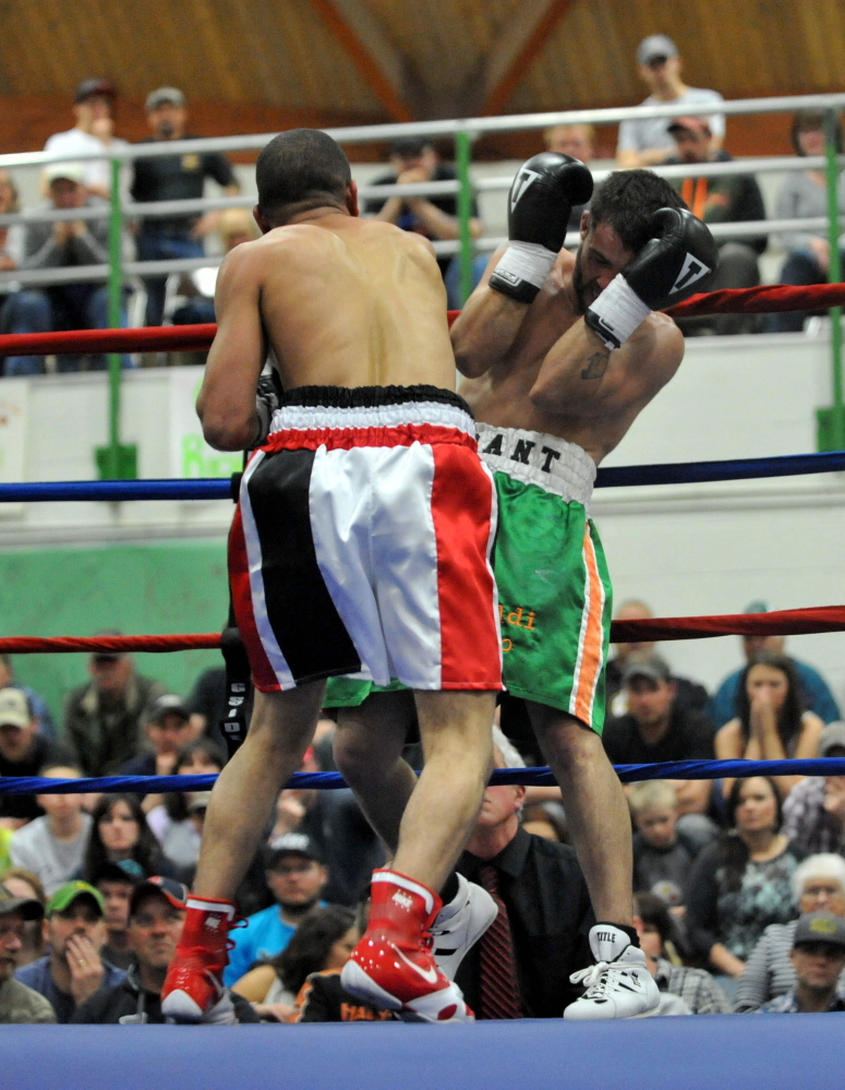 FIGHT NIGHT: Shane Tenney, green trunks, fights with Jorge Abiague in the first bout of the professional ranks at Wyman's Boxing Club Boxing Show at Carrabec High School in North Anson on Saturday night.