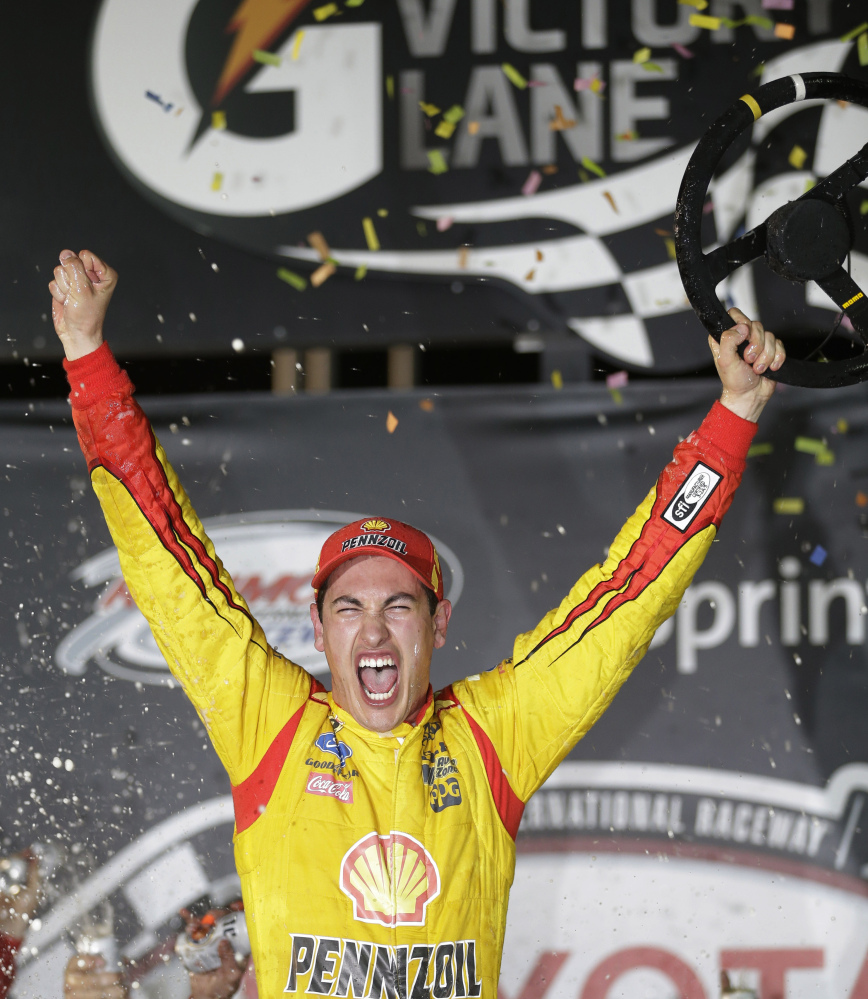 1ST TO FINISH: Joey Logano celebrates his win in the NASCAR Sprint Cup race Saturday night at Richmond International Raceway in Richmond, Va.
