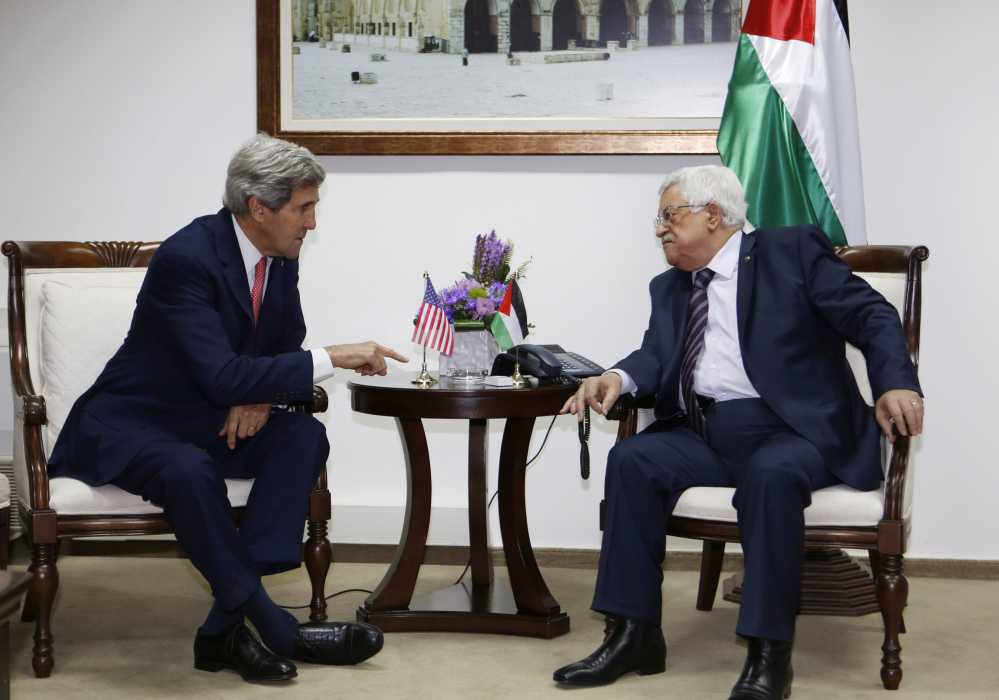 U.S. Secretary of State John Kerry meets with Palestinian President Mahmoud Abbas in the West Bank city of Ramallah in December.