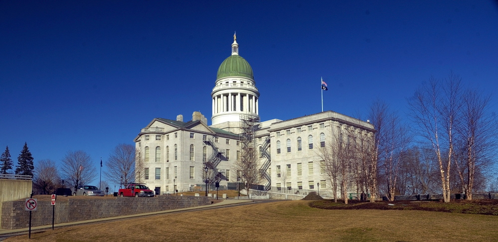 Changes: File photo of Maine State House taken on April 1 shows scaffolding beginning to be built around the dome in Augusta.