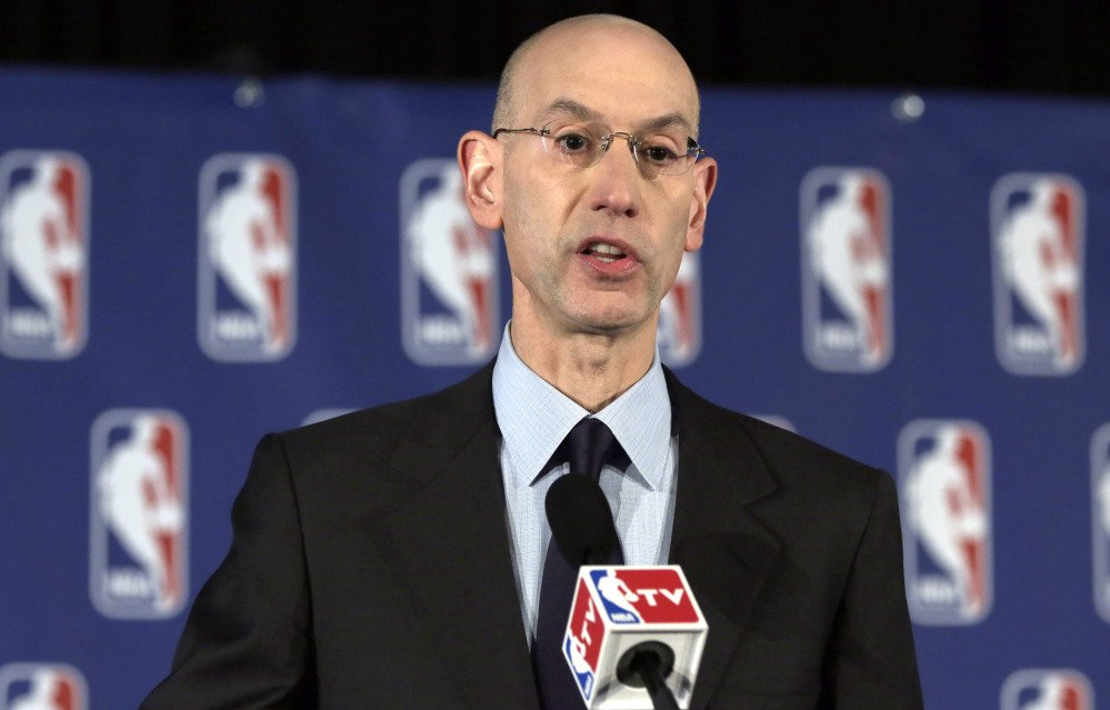 NBA Commissioner Adam Silver reads a statement during a news conference, in New York on Tuesday.