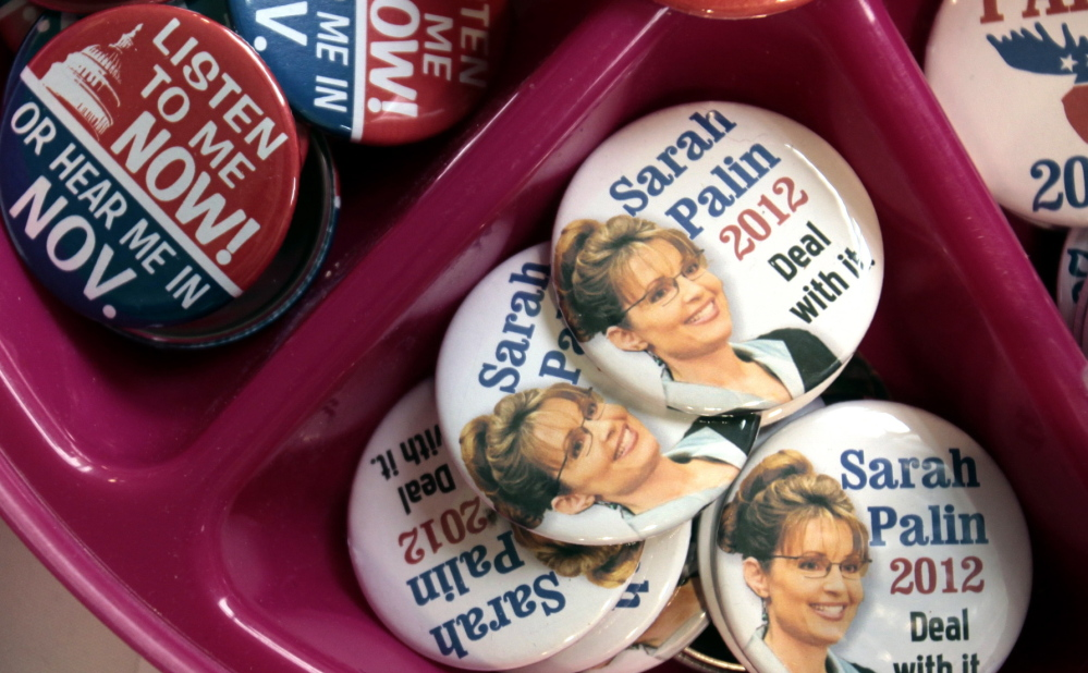 """Sarah Palin 2012"" buttons at the ""Americans for Prosperity"" summit"" in 2010"