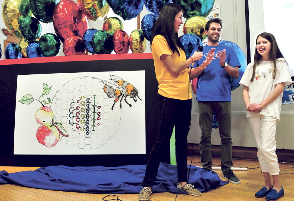 GOOGLE THIS KID: Sally Zhao and Sean Ivester of Google and the students and staff at the Albert Hall School in Waterville applaud fifth-grader Inga Zimba and her unveiled winning artwork in a national contest for the next theme for Google on Tuesday.