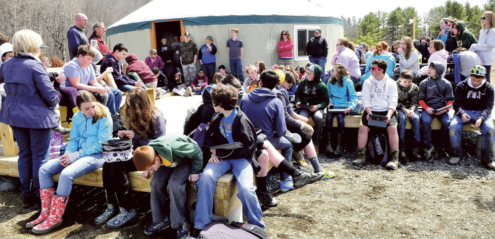 TRAILBLAZERS: Warsaw Middle School students listen to Matt Skehan, upper left, director of Waterville's Parks and Recreation Department, and former president of Kennebec Messalonskee Trails Peter Garrett on Tuesday at the Quarry Road Recreation Area.