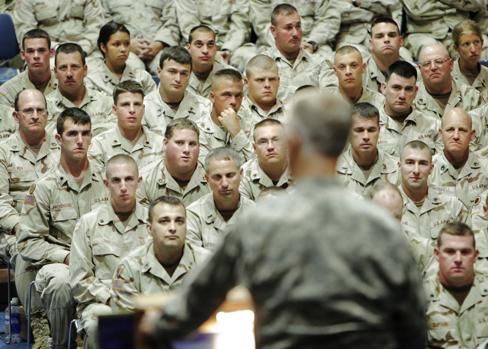 Soldiers from Company C, 133rd Engineer Battalion of the Maine Army National Guard listen to Gen. John Libby speak during a freedom salute ceremony at the Augusta Civic Center in 2005.