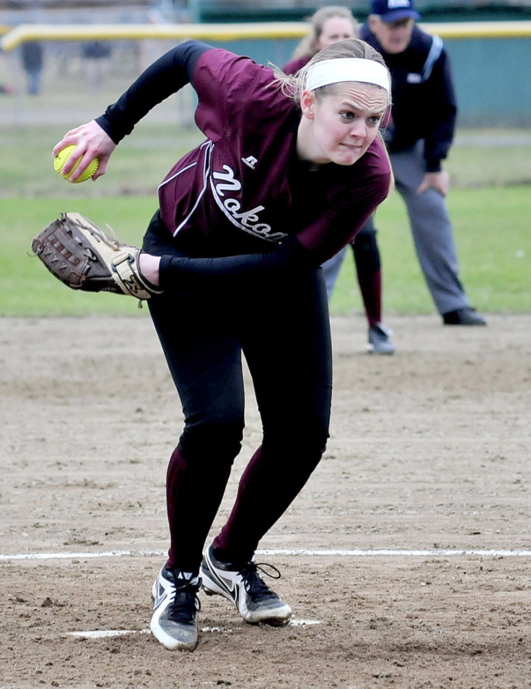 Staff photo by David Leaming INTENSITY: Nokomis softball pitcher Sara Packard winds up to throw against a Winslow batter recently.