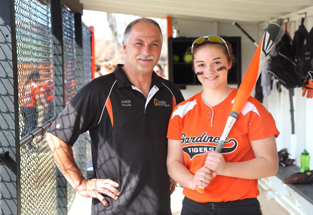 Photo by Jeff Pouland A FATHER/DAUGHTER DUO: As the assistant softball coach at Gardiner Area High School Don Brochu gets to coach a talented group of players which including his daughter, Brie.