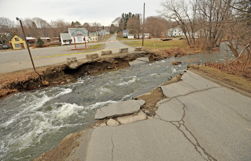 DEXTER FLOODING: A week after the east branch of the Sebasticook River flooded, Lincoln Street in Dexter remained impassible.