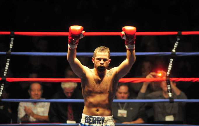 "Brandon ""The Cannon"" Berry, of West Forks, celebrates his victory third round KO victory over Paul Souza, of Somerville, Mass., in a four-round professional junior welterweight fight at the Portland Expo on Nov. 16, 2013."