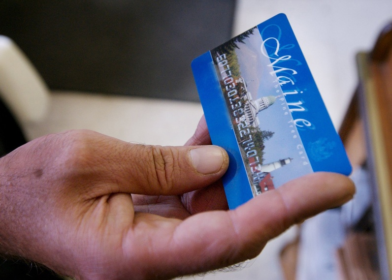 The LePage administration on Monday continued its public push to enact a slate of welfare reform proposals, an effort that could play into the upcoming election. Above, a Portland man uses an EBT card in 2008.