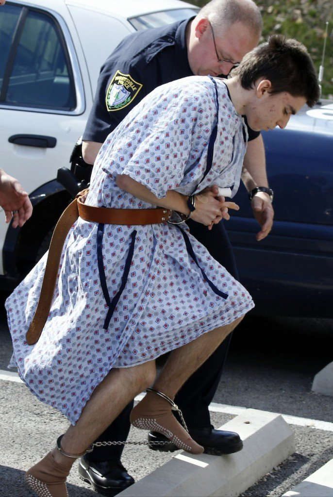 Alex Hribal, the suspect in the multiple stabbings at the Franklin Regional High School in Murrysville, Pa., is escorted by police to a district magistrate to be arraigned on Wednesday, April 9, 2014, in Export, Pa. Authorities say Hribal has been charged after allegedly stabbing and slashing at least 19 people, mostly students, in the crowded halls of his suburban Pittsburgh high school Wednesday.