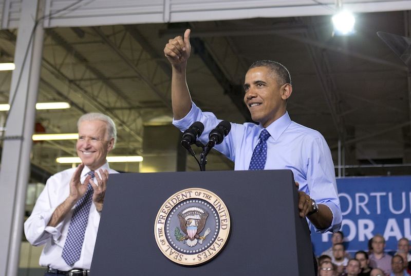 Vice President Joe Biden applauds, at left, as President Barack Obama gives the thumbs up as he speaks at the Community College of Allegheny County West Hills Center, Wednesday, April 16, 2014, in Oakdale, Pa., about the importance of jobs-driven skills training.