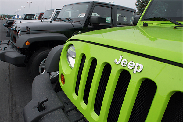 In this July 1, 2012 file photo, Jeeps sit for sale at a Chrysler dealership in Springfield, Ill. Fiat and Chrysler announced an agreement Saturday, April 19, 2014, that they will build three new Jeep models in China for the local market, the biggest for Jeeps outside the U.S.