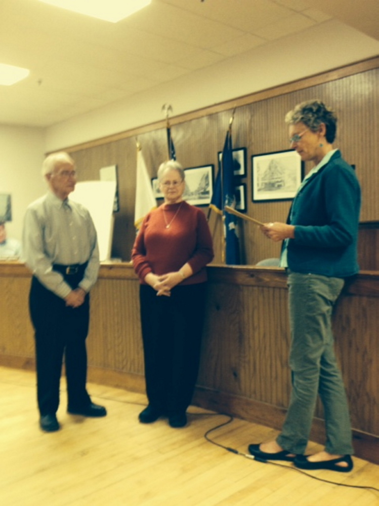 "Spirit of America Volunteers of the Year: Waterville Mayor Karen Heck, right, recently congratulated Earl, left, and Annette Rancourt, center, of Waterville, at a City Council meeting after they were named 2014 Spirit of America Volunteers of the Year. Heck read a proclamation saying the Rancourts have been tireless volunteers for the city as warden and ward clerk, respectively, for the last 15 years and have been responsible for managing many aspects of the voting process, including greeting and helping voters, administering election law, trouble-shooting, testing voting equipment and processing absentee ballots. The Rancourts, Heck said, have been outstanding members of the community and are active members of the business and church communities. ""The couple was part of a group of parishioners that started Notre Dame Credit Union on Aug. 27, 1956, and helped the credit union grow over many years,"" Heck said."
