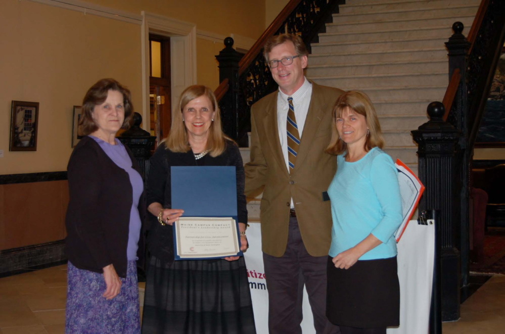 HONORED: The UMF Partnership for Civic Advancement was recently honored by the Maine Campus Compact with the President's Leadership Award at a ceremony in the State House Hall of Flags in Augusta. The award acknowledges exceptional campus contributions to community service, service learning and civic engagement efforts. From left are Lorraine Pratt, UMF grants writer, and F. Celeste Branham, UMF vice president of student and community services and director of the Partnership for Civic Advancement, received the award from Donald Tuski, president of the Maine College of Art, and Sally Slovenski, executive director of the Maine Campus Compact.