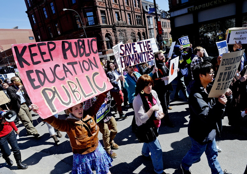Protesters march down Middle Street in Portland on April 10 as they protest budget cuts at the University of Southern Maine. USM students upset about the pending cuts made their case before the University of Maine System trustees Sunday.