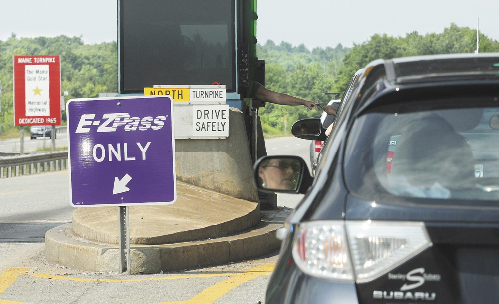 PAYING THE TOLL: Motorists in the northbound lane of Interstate 295 enter the Gardiner toll station.