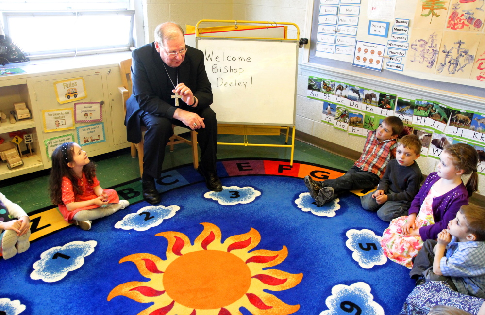 VISITING THE KIDS: Bishop Robert Deeley of the Roman Catholic Diocese of Portland visits with students in Sherri Fisk's prekindergarten class during a stop at St. John Regional Catholic School in Winslow on Friday.