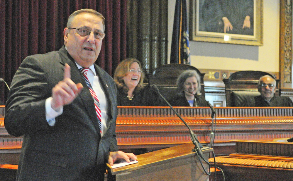 ROBING CEREMONY: Gov. Paul LePage, left, makes a joke during his opening remarks during a swearing in ceremony on Friday at Kennebec County Superior Court in Augusta.