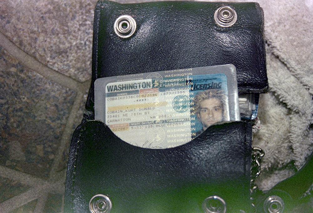 This April 1994 photo from the Seattle Police Department shows a wallet containing Kurt Cobain's Washington state driver's license, found at the scene of his suicide, in Seattle.