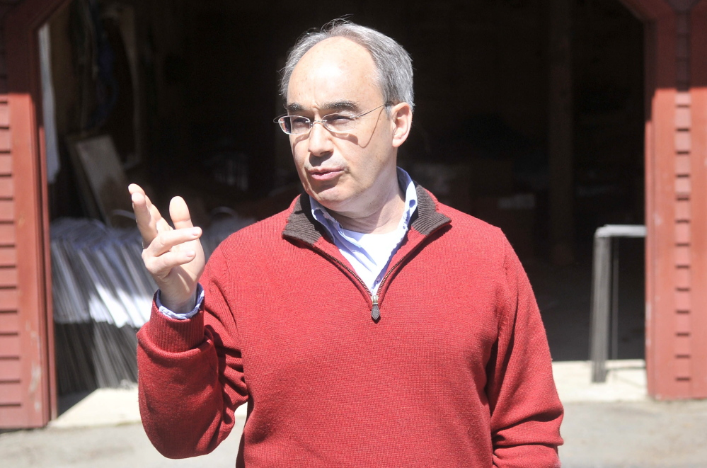 Bruce Poliquin, a candidate for the Republican nomination for the 2nd Congressional District seat, talks about his connection to Oakland and Waterville from his driveway in Oakland.