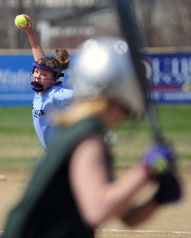 Here's the pitch: MacPage 10-and-under pitcher Raylee Gilbert throws to a Northwoods batter during opening day of softball season on Saturday at the CAYSA complex in Augusta.