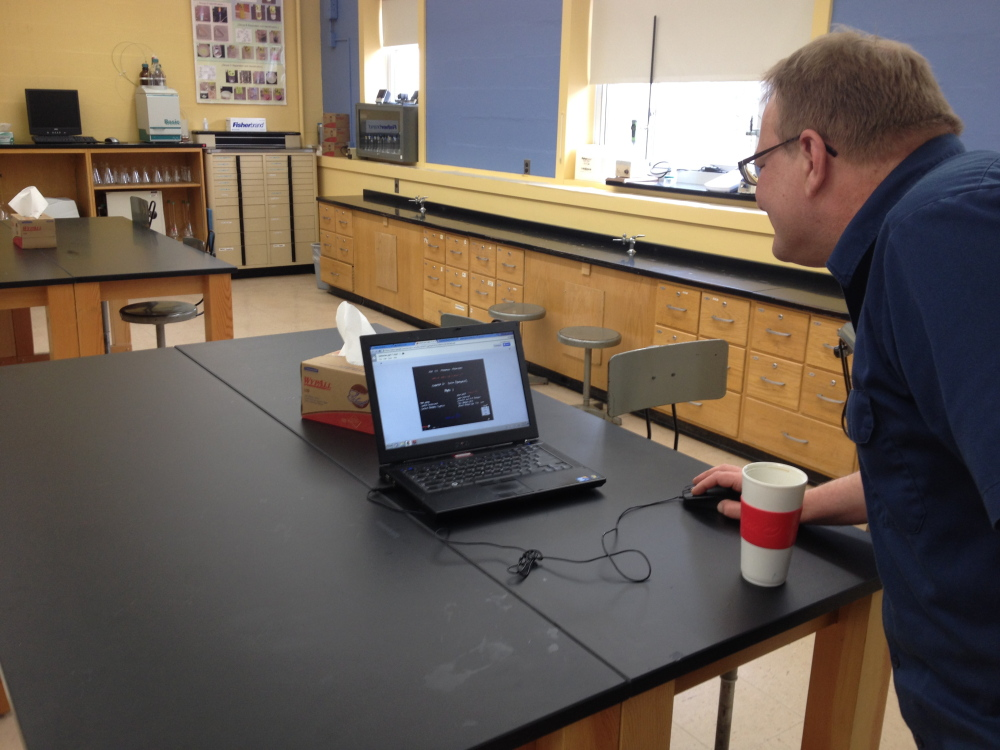 High tech: Terry Morocco, UMF associate professor of chemistry, demonstrates an online slideshow as part of his new online class Caveman Chemistry.