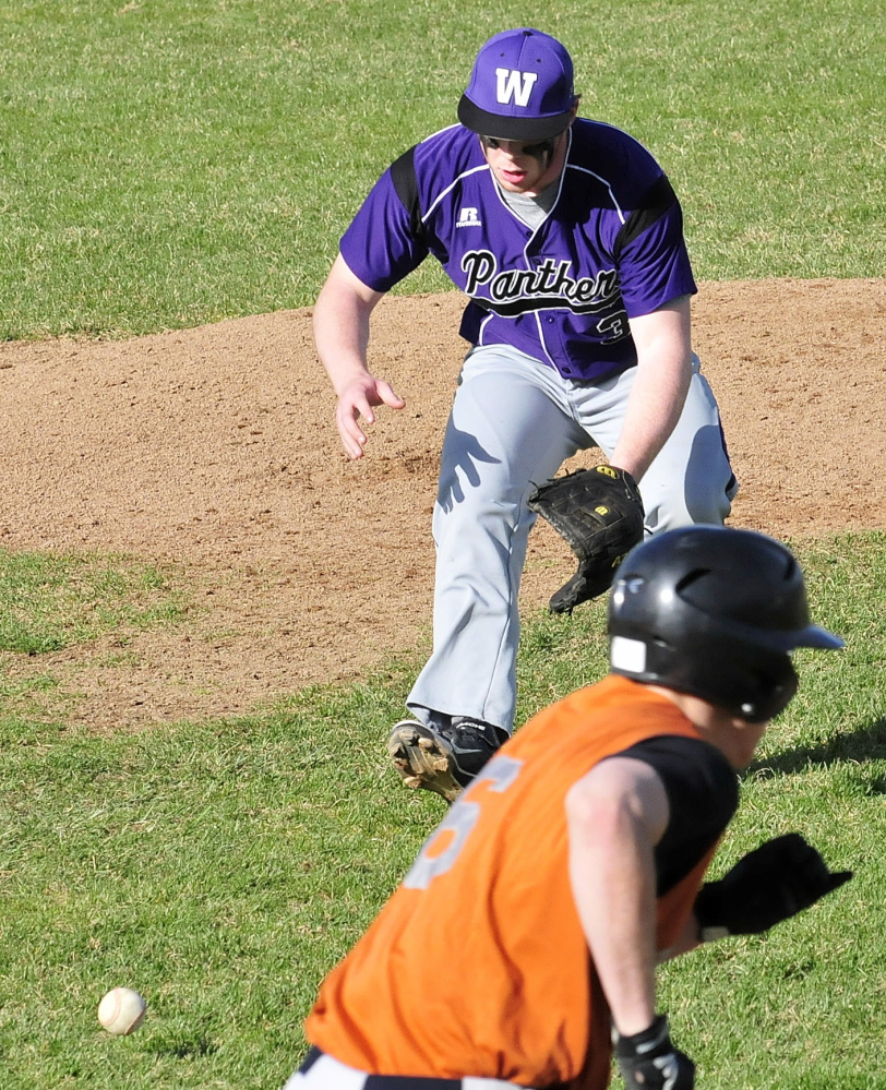 Staff photo by David Leaming Waterville pitcher Dan Pooler chases down the ball and throws to first for the out against Gardiner on Monday, May 5, 2014.