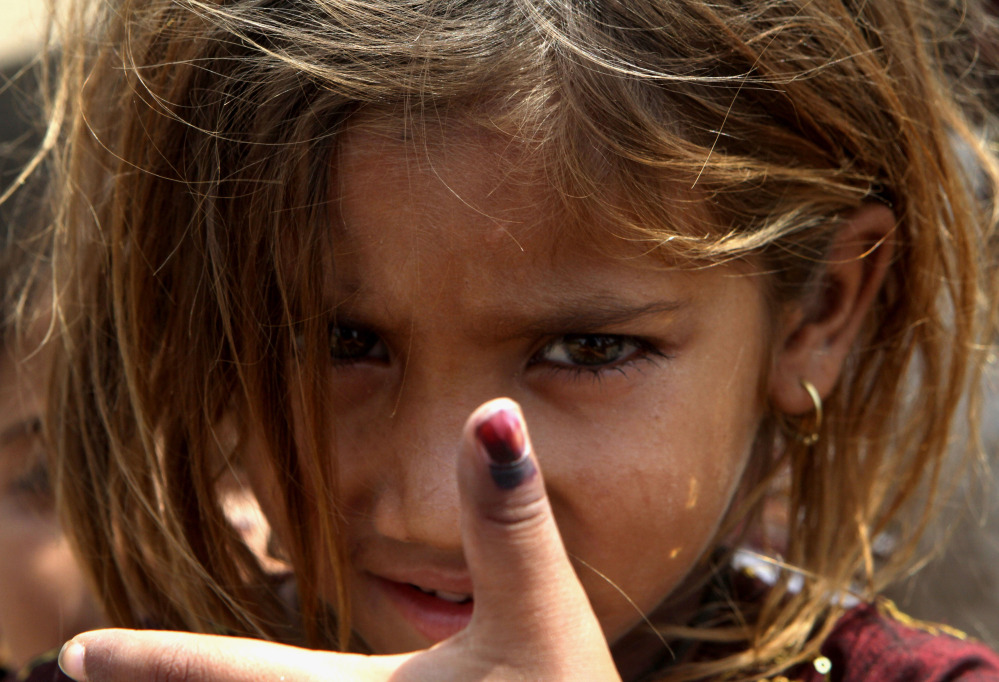 Pakistani girl Amina shows her thumb being marked after receiving polio vaccine in Lahore, Pakistan, Monday, May 5, 2014. For the first time ever, the World Health Organization on Monday declared the spread of polio an international public health emergency that could grow in the next few months and unravel the nearly three-decade effort to eradicate the crippling disease.