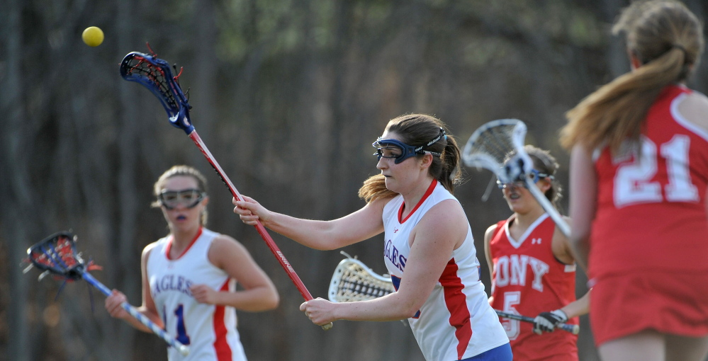 MULTITALENTED: Messalonskee High School's Ally Fischang, 15, credits swimming and cross country running in helping with her lacrosse game. Fischang, a senior, is the Eagles' top scoring threat.