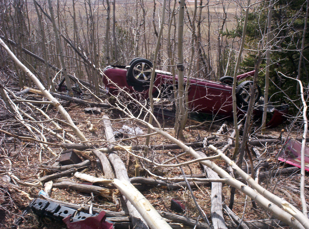 In this photo provided by the Park County Sheriffís Office, Kristin Hopkins' car is seen after she drove off the roadway near the old mining town of Fairplay, Colo., sometime after she was last seen on April 27.