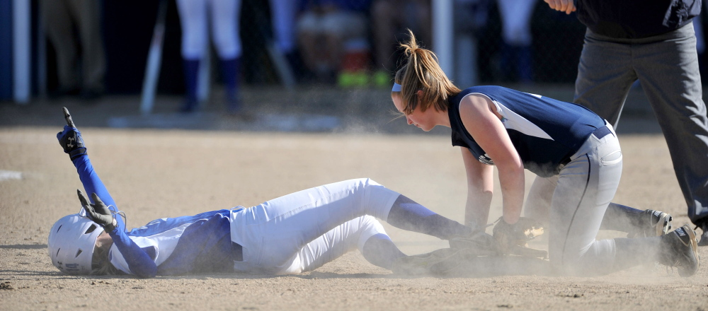 Staff photo by Michael G. Seamans Madison High School's Cristie Vicniere, 14, slides safely in to second base under the tag of Dirigo High School's Lauren Henderson, 5, right, in Madison on Wednesday. Madison defeated Dirigo 12-0 in six innings.