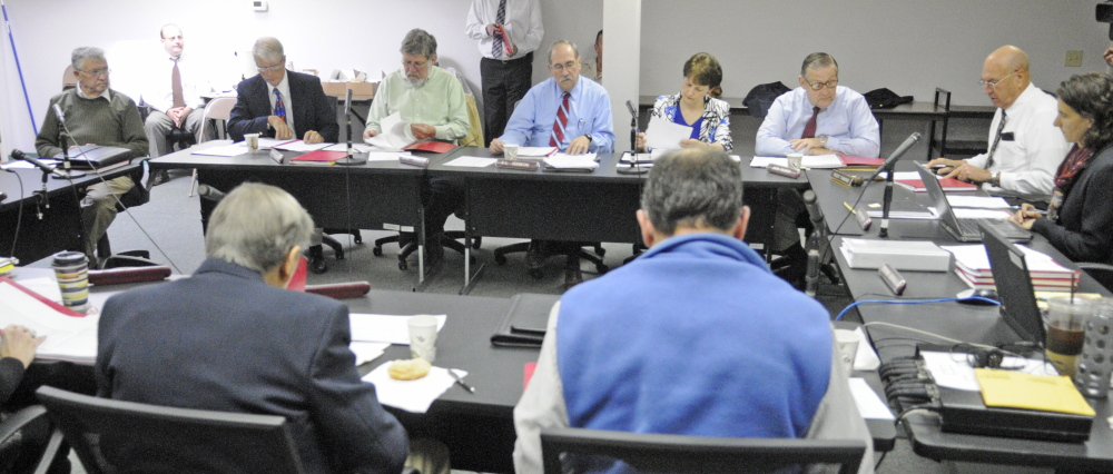 Russ Edwards, owner of the Meadowbrook Trailer Park in Richmond, far left, speaks during a hearing on Wednesday before the The Manufactured Housing Board in Gardiner.