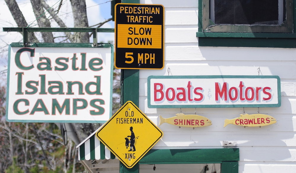 "NEW LOCATION: The ""Pedestrian Traffic Slow Down 5 MPH"" sign that had been on a post near Castle Island Camps is now hanging on the building in Belgrade."