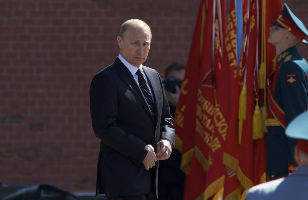 Russian President Vladimir Putin takes part in the wreath laying ceremony at the Tomb of the Unknown Soldier at the Kremlin wall in Moscow, Russia, Thursday. He also was present for a Russian nuclear forces exercise.
