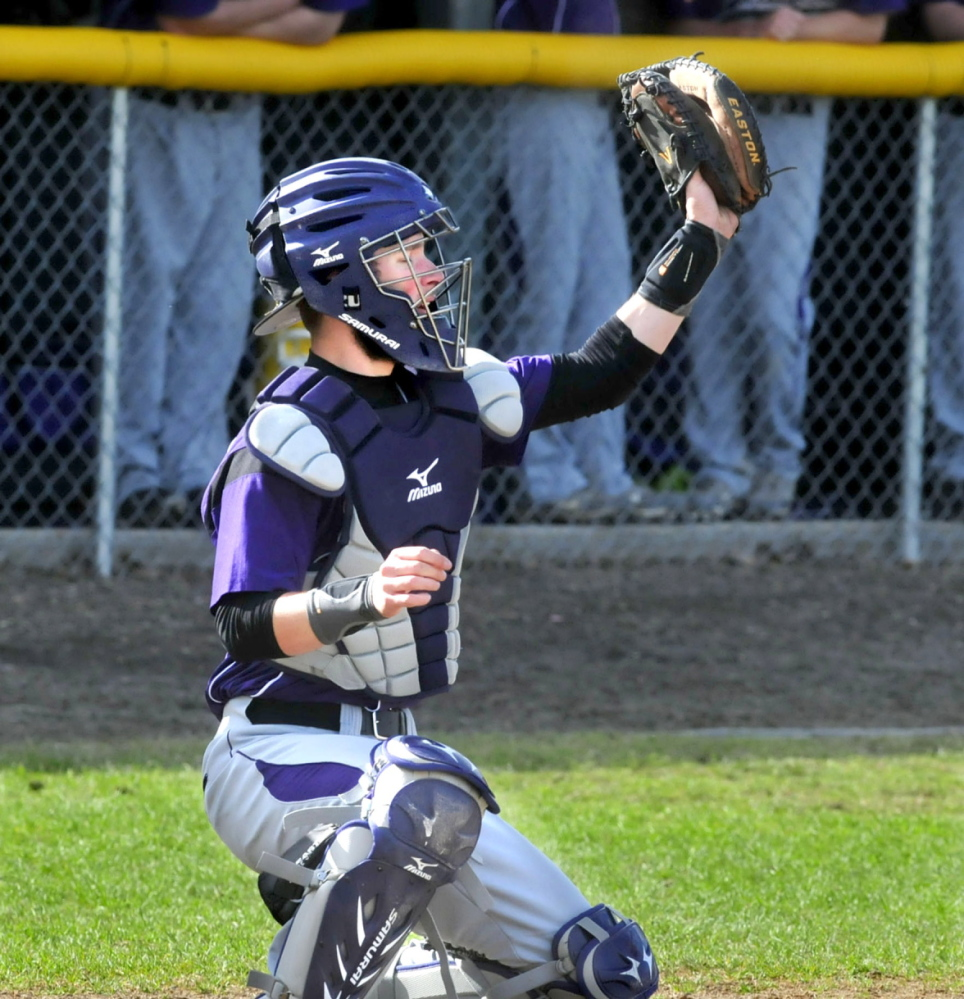 Staff photo by David Leaming Waterville baseball catcher Aidan FitzGerald makes a catch during a recent game against Gardiner.