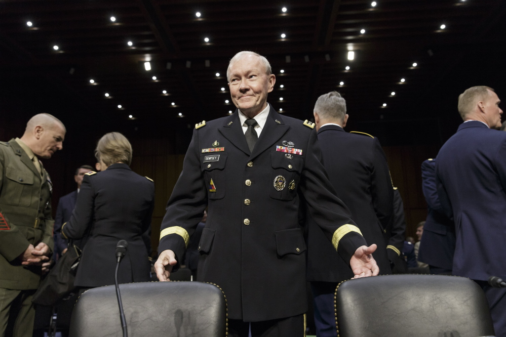 Chairman of the Joint Chiefs of Staff Gen. Martin E. Dempsey arrives to testify before the Senate Armed Services Committee about Department of Defense proposals on military pay and compensation, on Capitol Hill in Washington, Thursday.
