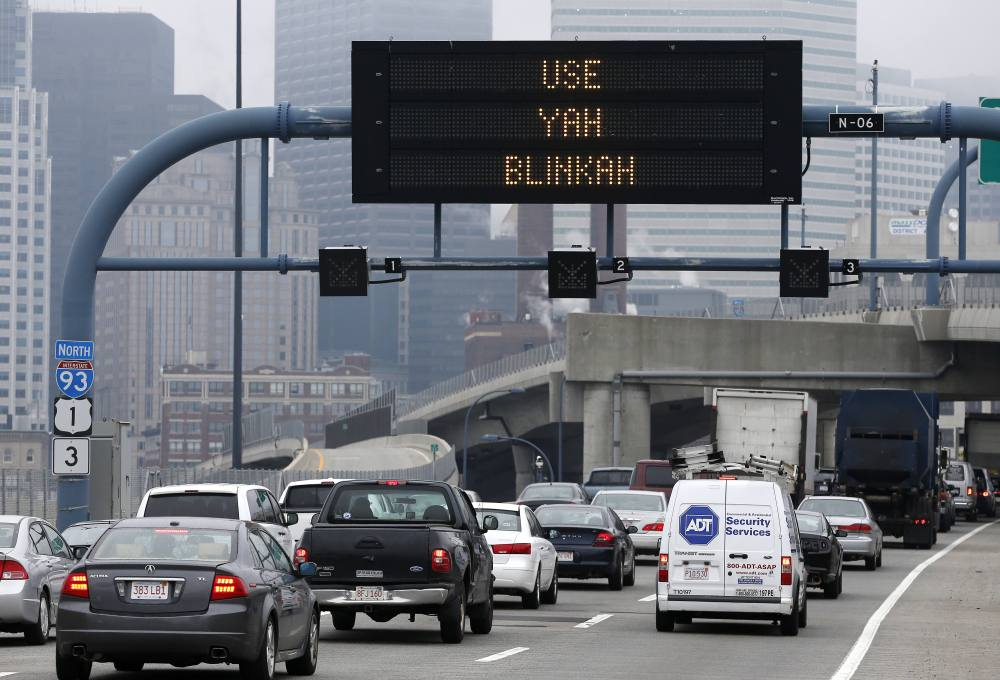The message is clear on this electronic sign over Interstate 93 in Boston Friday.