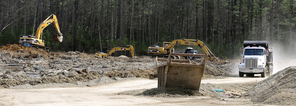 TRANSPORTATION MOVE: Earth moving equipment prepares the site where a pole barn will be built at the state's future fleet maintenance center at 66 Industrial Drive in north Augusta.