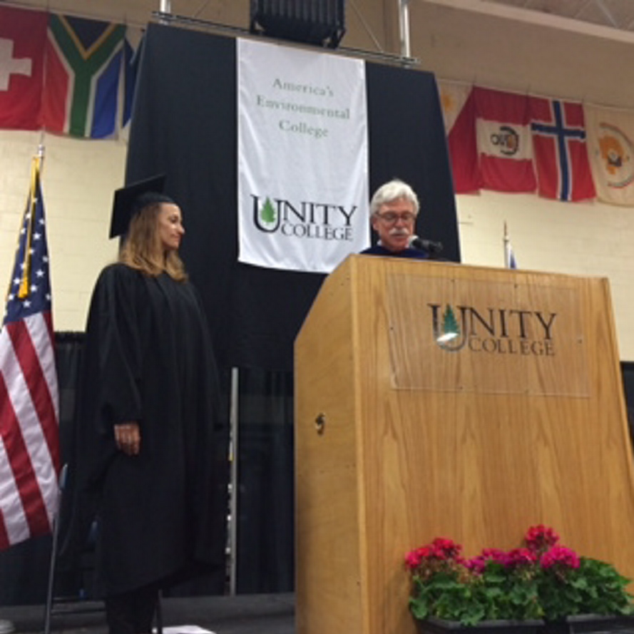 Unity College President Stephen Mulkey introduces keynote speaker Celine Cousteau at Saturday's commencement on May 10, 2014. Staff photo by Rachel Ohm.