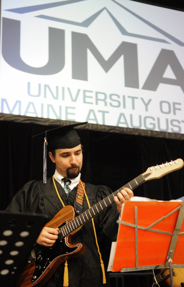 FRET-FREE DAY: Rurik Brackett plays guitar with the UMA Jazz on Tour band before the University of Maine at Augusta graduation ceremony Saturday at the Augusta Civic Center.