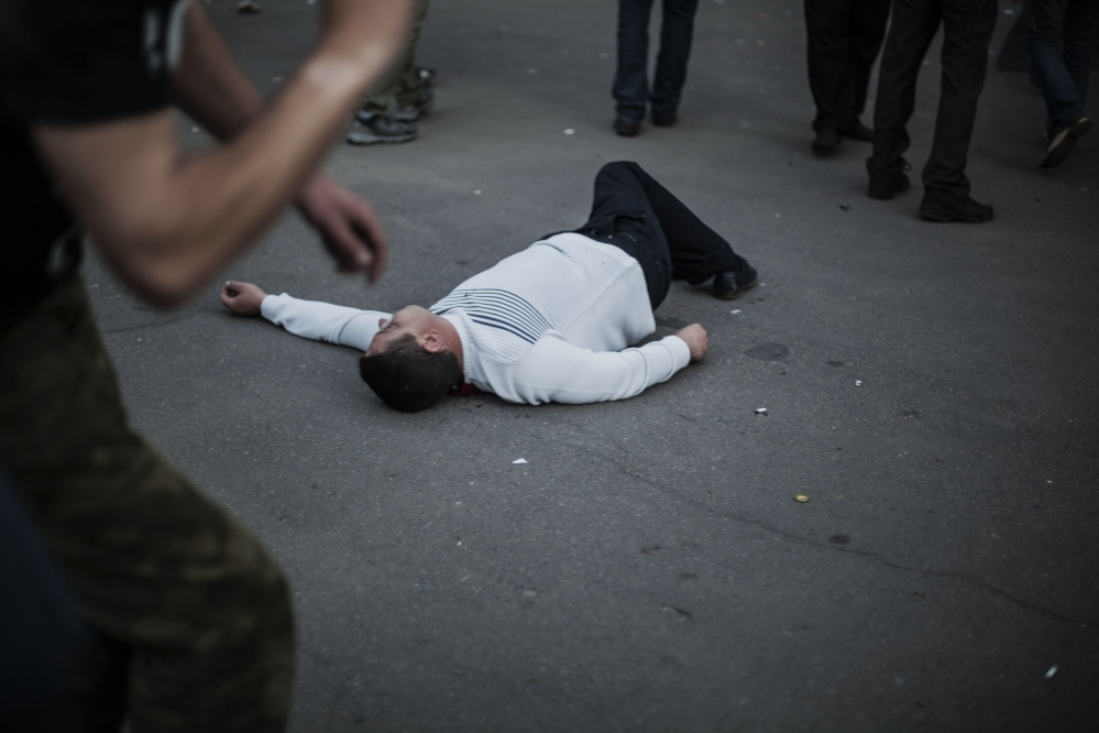 The body of a pro-Russia man lies on the ground in Krasnoarmeisk, Ukraine, Sunday.