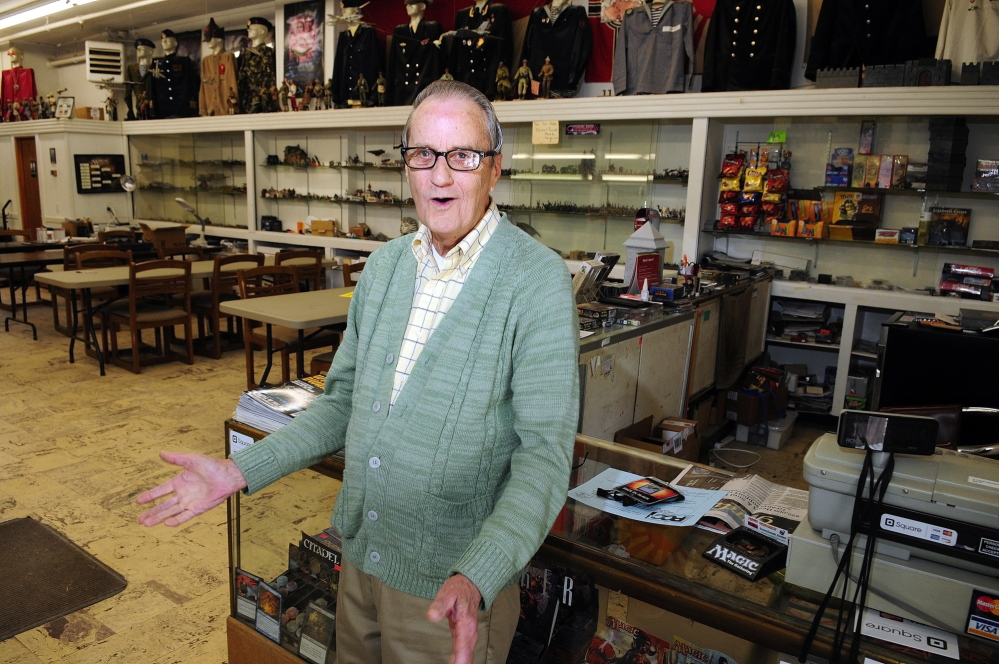 Storefront: Frank Hillman, the owner of 269-273 Water St. in Gardiner, talks about flood insurance rates on Thursday in Gardiner. The storefront there is his son's business, Greenhouse Games.