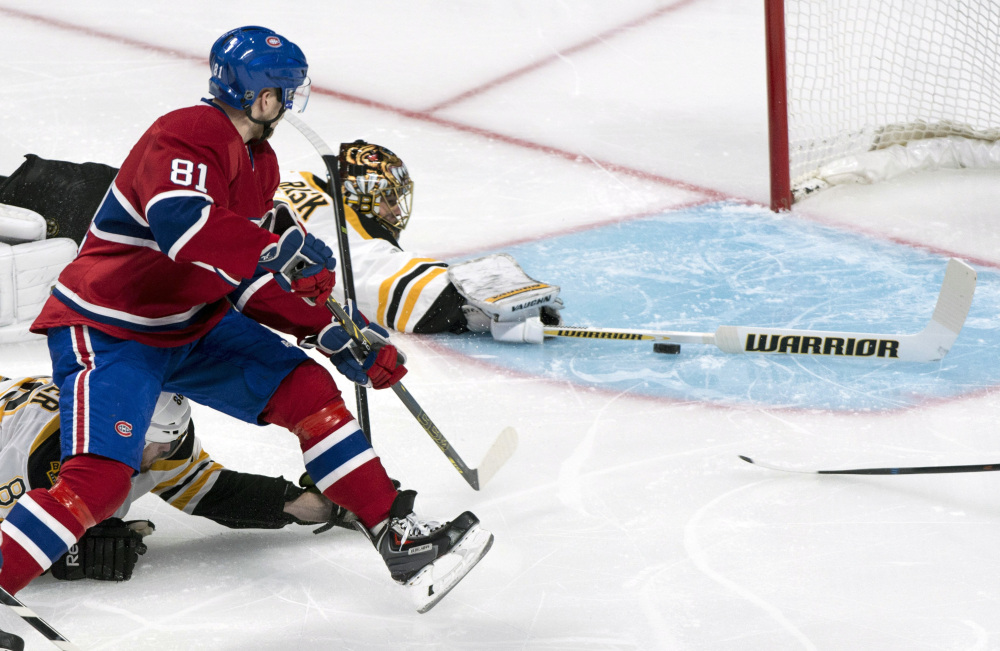 Montreal Canadiens' Lars Eller (81) scores on Boston Bruins goalie Tuukka Rask during the first period Monday night in Montreal.