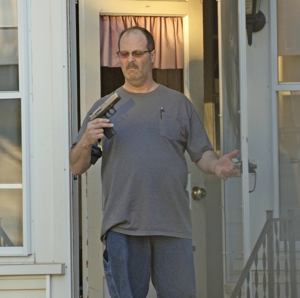 CHARGES: A picture taken by Barry Sturk, Susan Morrisette's boyfriend, shows her ex-husband, Wilfred Morissette holding a handgun on First Street in Winslow Sunday night. Wilfred Morissette was arrested and charged after he allegedly pointed the loaded gun at Susan Morissette, Sturk and their children.