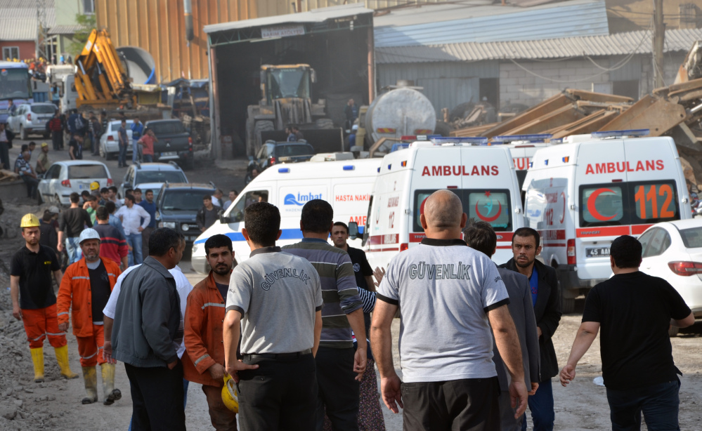 Rescue workers and ambulances at the entrance of the mine after an explosion and fire at a coal mine in Soma, in western Turkey on Tuesday.