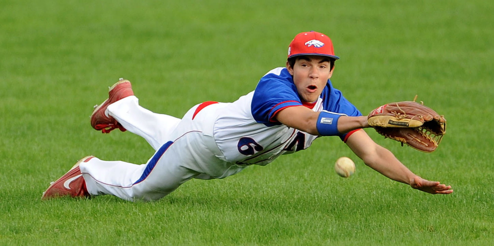 LAYING OUT: Messalonskee center fielder Noah Caret dives for a fly ball in a game against Bangor on Wednesday in Oakland. Messalonskee defeated Bangor 4-3 in the bottom of the 7th inning.