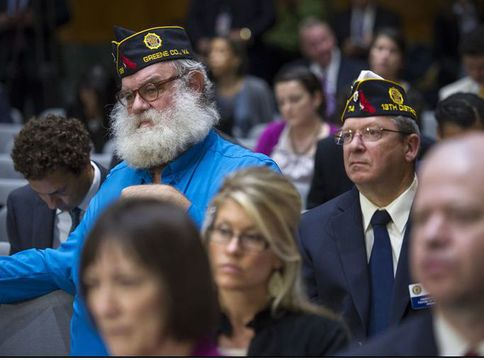 """Members of the American Legion listen as Veterans Affairs Secretary Eric Shinseki testifies at a Senate committee hearing on the state of health care for veterans. Shinseki said he was """"mad as hell"""" about allegations that some VA hospitals falsified reports so it looked like their wait lists were shorter."""