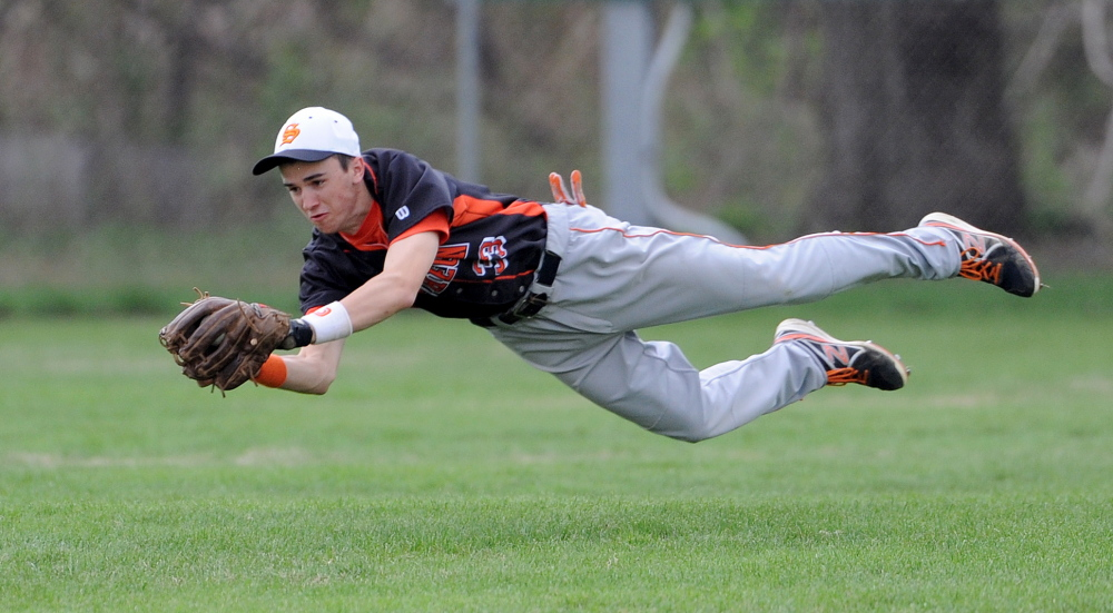 Staff photo by Michael G. Seamans Skowhegan Area High School's Chase Whittemore, 33, makes a diving catch to rob Mt. Blue High School of a hit in Farmington on Friday, May 16, 2014. Skowhegan defeated Mt. Blue 4-2.